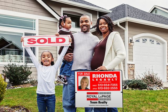 Happy family sold their home with the help of Rhonda Legault