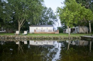 Waterfront cottage on private road.    Lot size 100' x 150'.